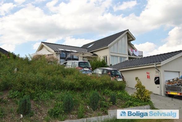 Huset i 2010 da haven ikke var så opvokset.